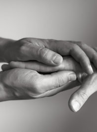 Hand holding another hand. People helping and comforting each other concept